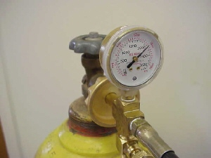 Filling the tank for the Model 610 Pressure Chamber PMS Instruments